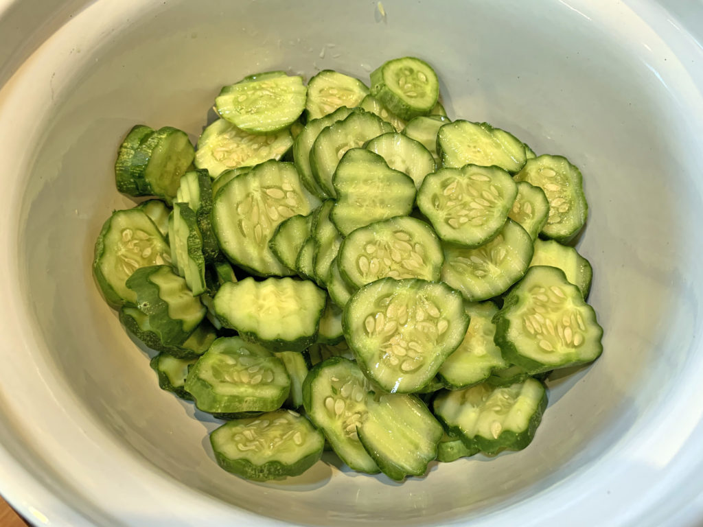 Sliced gherkins in a bowl.